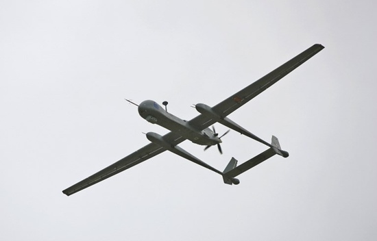 (FILES) A file picture taken on February 21, 2010 shows an Israeli Heron TP surveillance drone, known as the IAI Eitan, flying during a presentation to the media at the Tel Nof Air Force base, south of Tel Aviv. Germany has signed a $600 million, nine year deal to lease Israeli military reconnaissance drones capable of carrying missiles, the aircrafts manufacturers said on June 14, 2018. The Heron TP Medium Altitude Long Endurance drones will be maintained by European aerospace giant Airbus, which will also provide operational support, state-owned Israel Aerospace Industries said in a statement. Jonathan Nackstrand/AFP