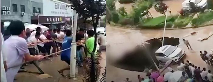 """สามัคคีคือพลัง! ชาวบ้านช่วยดึงรถยนต์ที่เกือบตก """"หลุมยุบ"""" หลังฝนตกหนักที่ส่านซี [ชมคลิป]"""