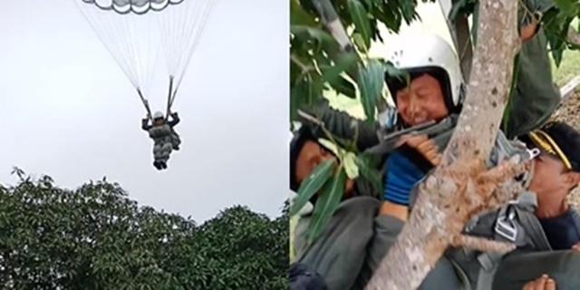 ตำรวจพลร่มซ้อมโดดร่ม ลงผิดจุดตกพุ่มไม้ได้แต่ยิ้มแก้เก้อ