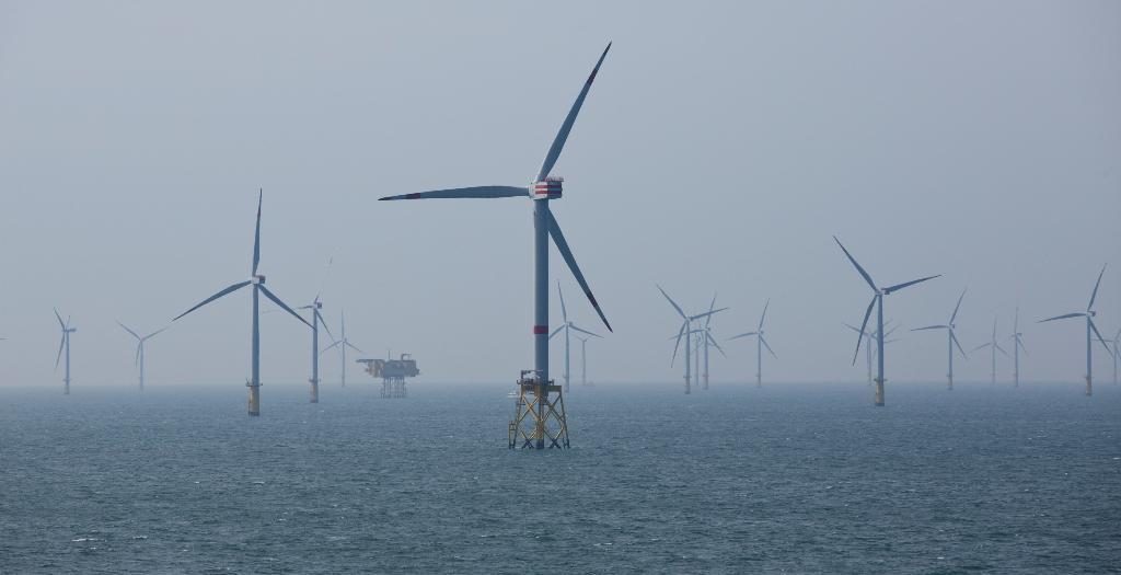 พลังงานลมเป็นหนึ่งในพลังงานสะอาดที่ช่วยเยอรมันลดใช้เชื้อเพลิงฟอสซิล (REUTERS/Christian Charisius/Pool/File Photo)