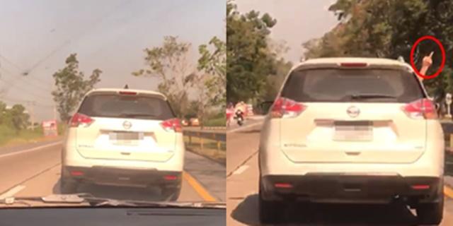 รถยนต์อเนกประสงค์ สีขาว ขับแช่ขวาส่ายไป-มา แถมชูนิ้วกลางใส่ (ชมคลิป)