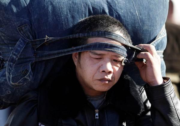 """""""กองทัพใหญ่ชุนอวิ้น"""" เดินทางฉลองตรุษจีน คาดทุบสถิติร่วม 3,000 ล้านเที่ยว"""