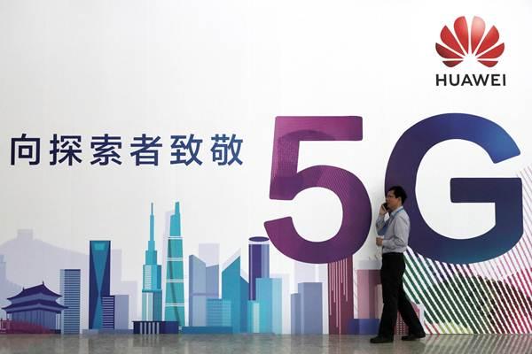 ป้ายโฆษณาเทคโนโลยี 5G ของหัวเว่ย ในงาน PT Expo ในปักกิ่งเมื่อเดือนก.ย. 2018 (ภาพ รอยเตอร์ส)