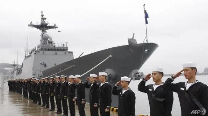 """กองทัพเรือเกาหลีใต้ทำพิธีเปิดหน่วยปราบโจรสลัด """"ชองแฮ"""" ที่เมืองปูซาน เมื่อวันที่ 3 มี.ค. ปี 2009 (Photo: AFP/CHOI JAE-HO)"""