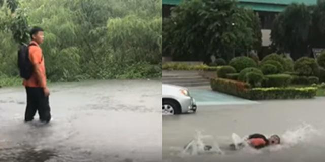 """ฮาทั้งโซเชียลฯ หนุ่มน้อยว่ายน้ำท่วมขังไปโรงเรียน หลังเจอสถานการณ์ """"พายุโพดุล"""""""