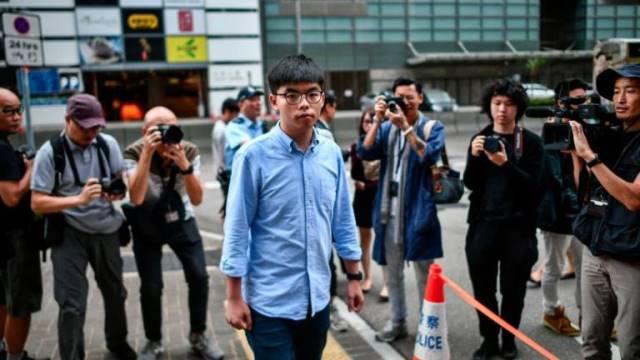 """จีนหนุนฮ่องกงตัดสิทธิ """"โจชัว หว่อง"""" ลงเลือกตั้งท้องถิ่น"""