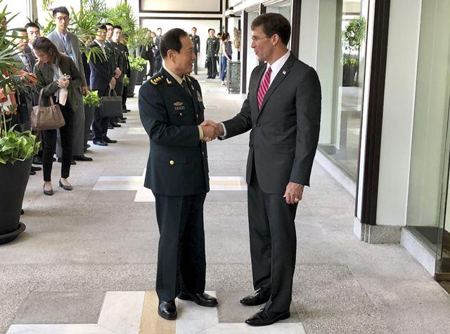 """จีนขอสหรัฐฯ """"เลิกอวดเบ่งอำนาจ"""" ในทะเลจีนใต้"""