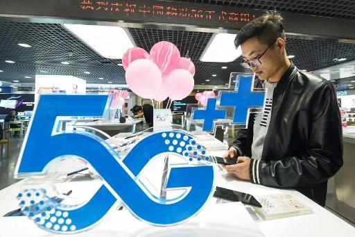 ทางการจีนบังคับผู้เปิดเบอร์โทรศัพท์ใหม่สแกนภาพใบหน้า (แฟ้มภาพเอเอฟพี)