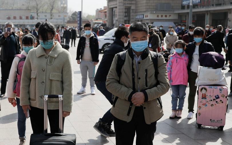 In Pics: จีนจัดพิธี 'ไว้อาลัย' ผู้เสียชีวิตจากการระบาดของ 'โควิด-19'