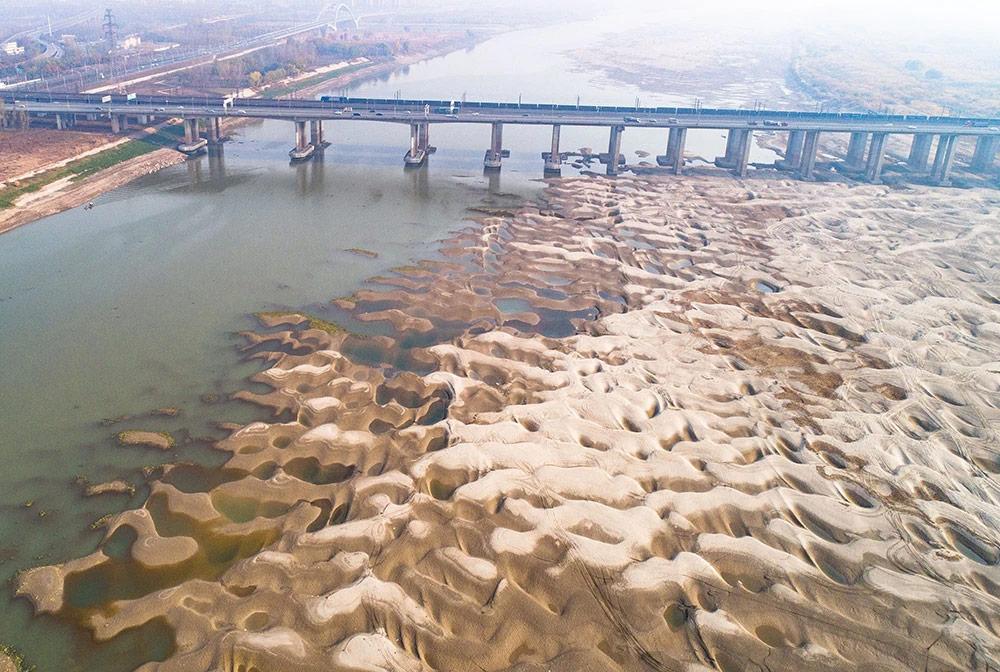 เกาะกลางแม่น้ำเทียนซิ่งโจว (ภาพ : ซินหัว)