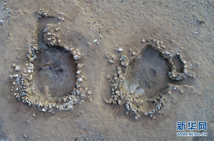 ร่องรอยของบ้านกึ่งฝังดินที่ขุดพบบริเวณเหมืองหยก เมืองตุนหวง มณฑลกานซู่