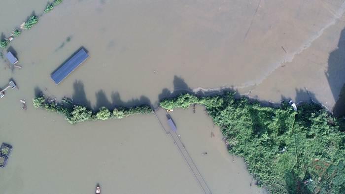 เขื่อนหนันคังในทะเลสาบโผหยัง ภาพถ่ายเมื่อวันที่ 12 ก.ค. 2020 (แฟ้มภาพซินหัว)