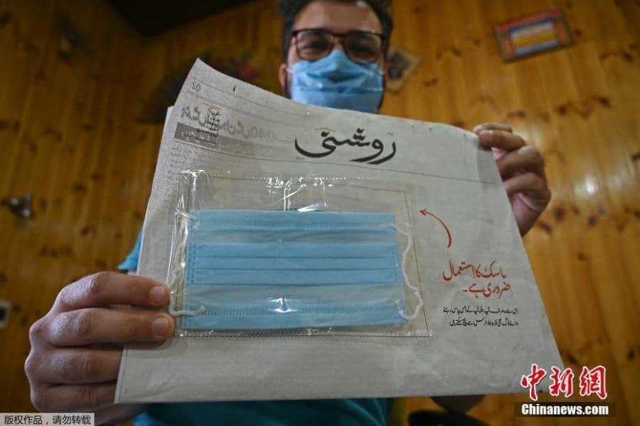 ไอเดียดี! หนังสือพิมพ์ในอินเดีย แจกหน้ากากอนามัยฟรี เพื่อป้องกันเชื้อไวรัสหลังระบาดหนักในประเทศ