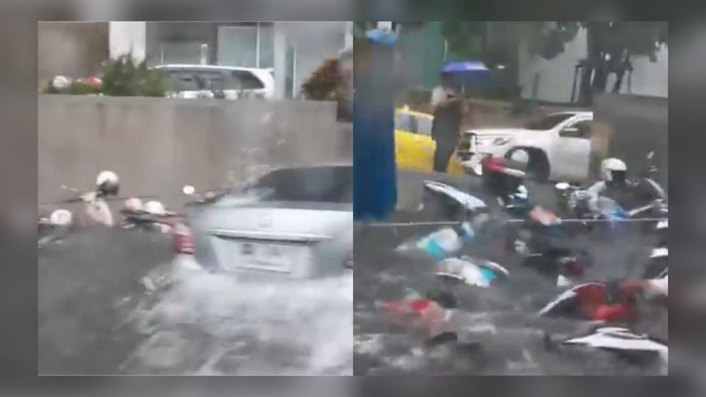 แห่แชร์! เหตุรถยนต์ขับฝ่าน้ำท่วมสูง ซอย อสมท. เกิดคลื่นพัดมอ'ไซค์ ล้มระเนระนาด (ชมคลิป)
