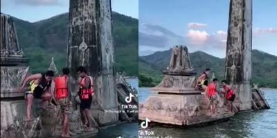 โซเชียลฯเดือด! กลุ่มวัยรุ่นปีนเมรุเก่าอ่างเก็บน้ำคลองกะทูน หมู่บ้านเก่าที่จมน้ำจากภัยพิบัติกว่า 30 ปี