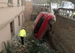 Car falls into a pit