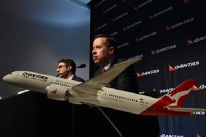 Qantas flags lower interim earnings