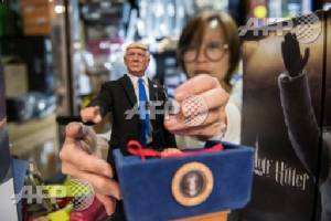 Hong Kong doll maker toys with Trump