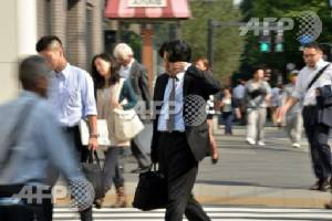 Death by overwork: Japan's 100-hour overtime cap sparks anger
