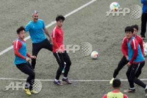 Pork, sweets off menu for 'fat' Chinese footballers as Spanish take charge