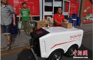 JD.com คู่แข่งอาลีบาบา เปิดตัวหุ่นยนต์และรถส่งของไร้คนขับ