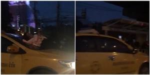 อย่างชิล! มนุษย์ป้า นอนบนฝากระโปรงรถแท็กซี่พร้อมเล่นมือถือ ไม่แคร์สายตาใคร
