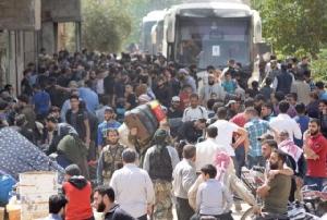 """กบฏซีเรียเริ่มถอนกำลังจาก """"พื้นที่ปิดล้อม"""" แห่งสุดท้ายแล้ว"""