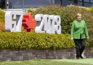 Merkel 'may well' travel to Russia World Cup