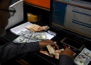 ทุนสำรองเงินตราระหว่างประเทศของจีนเพิ่มขึ้นสูงสุดตั้งแต่ เม.ย. 60