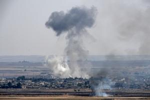กลุ่มควันจากการสู้รบที่เมือง ราสอัล-อัยน์ ในซีเรียเมื่อวันที่ 14 ต.ค. หลังตุรกีเปิดปฏิบัติการโจมตีกองกำลังเคิร์ดเข้าสู่วันที่ 6