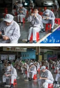 (ชมภาพ) คนงานอู่ฮั่นนั่งกินข้าวเที่ยงห่าง 2 ม. หลัง รง.เปิดผลิตอีกครั้ง