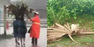 ชื่นชม! ตำรวจจราจร สภ.กบินทร์บุรี เอาใบตาลแห้งทำร่มให้นักเรียนท่ามกลางสายฝน