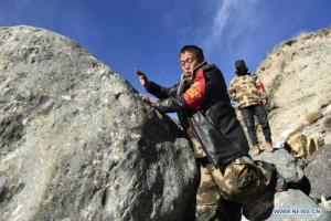 (ภาพ) เจ้าหน้าที่ป่าไม้จีน ลาดตระเวนวันละ 20 กม. ปกปักษ์อุทยานแห่งชาติ