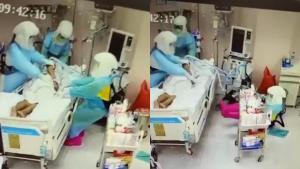 เผยนาที! พยาบาลสาวในชุด PPE  ล้มหงาย หลังช่วยผู้ป่วยโควิดพลิกตัว (ชมคลิป)