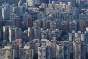 ที่ผ่านมา ราคาอสังหาริมทรัพย์ตามเมืองต่าง ๆ ในจีนแตกต่างกันอย่างมาก  (แฟ้มภาพเอเอฟพี)